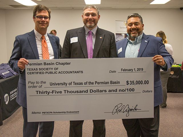 Texas Permian Basin CPAs presenting a check to the CPA program at UT Permian Basin