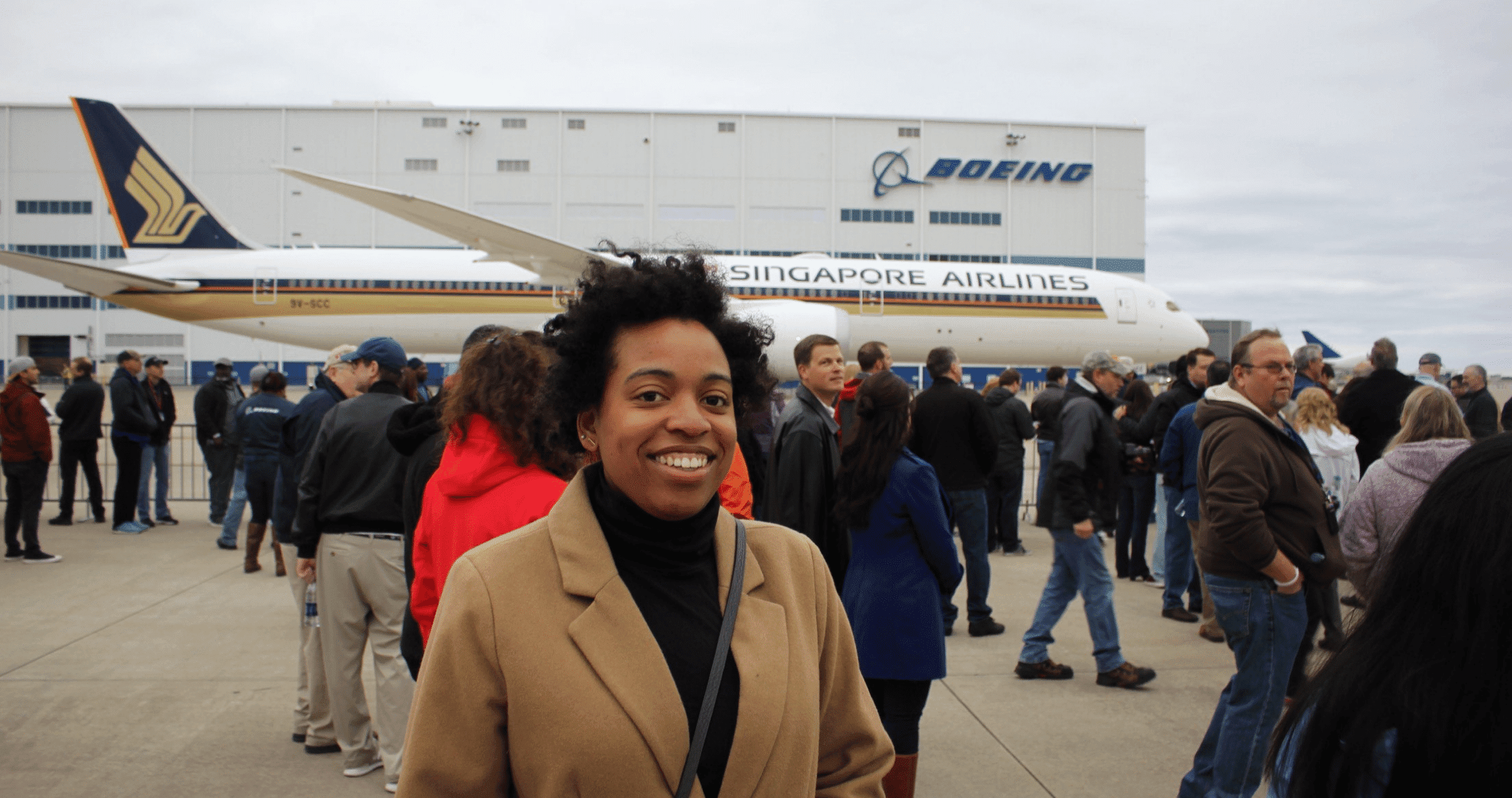 Clarissa Mcmillar smiling in front of Boeing planeoeing