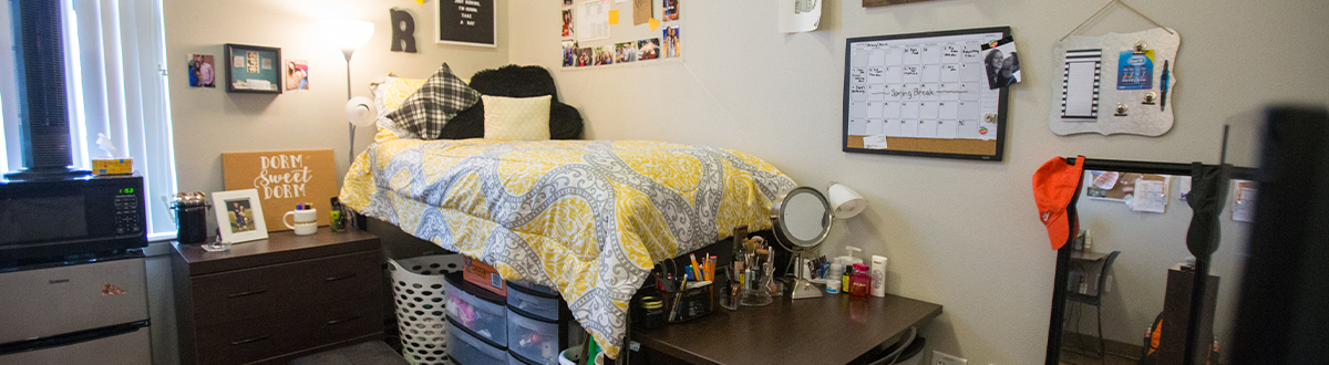 inside a campus dorm with bed and decorations