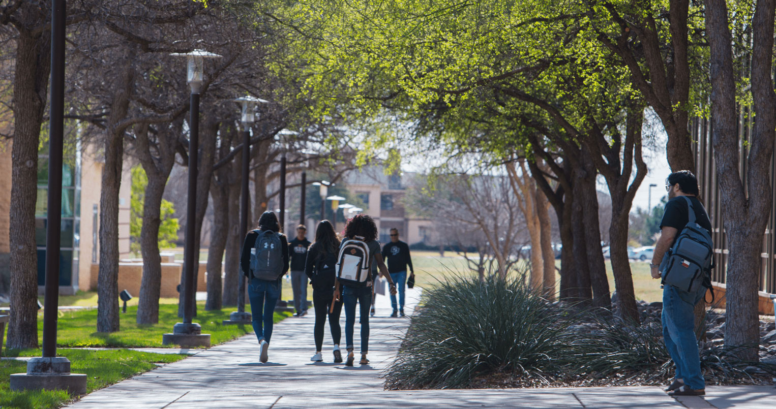 students walking in quad on campus