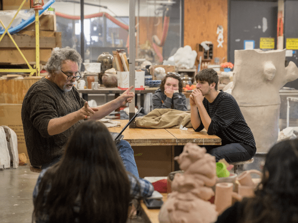 Chris Stanley teaching art class