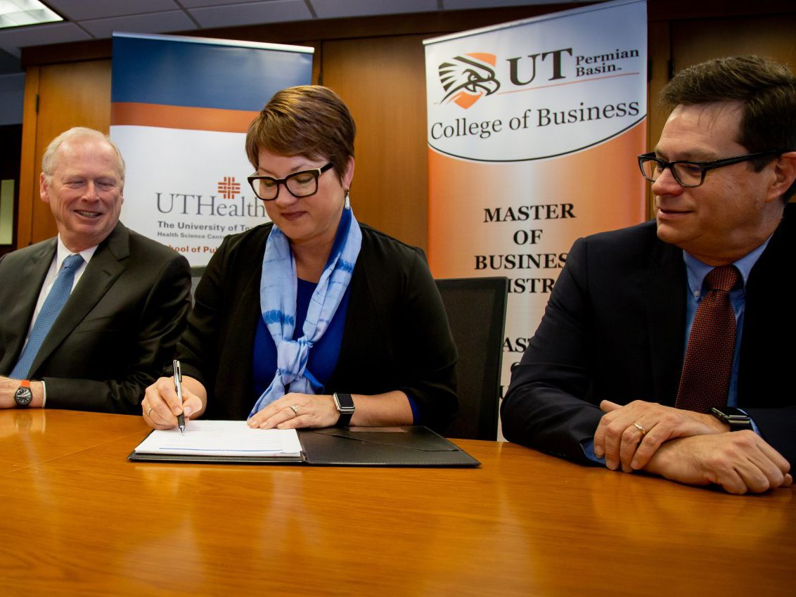 Dr. Woodley signs partnership agreement with UTHealth